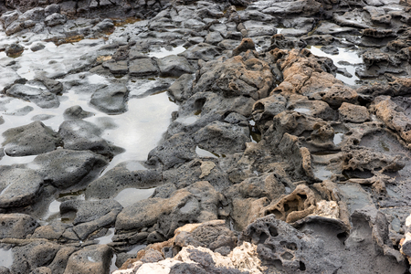 Closeup of volcanic lava stones on beach in Fuerteventura. Canary Islands. spain