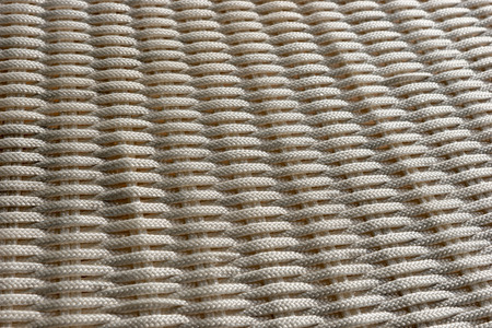 Woven light background. Simple abstract background of bright ropes Stock Photo