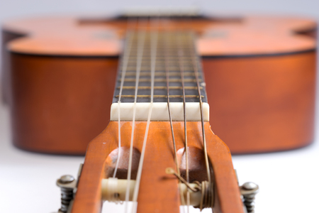 Fretboard of old classical guitar. Stringed musical instrument