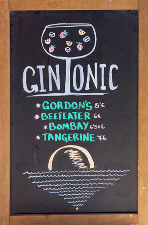 Advertising sign for gin and tonic in front of a restaurant