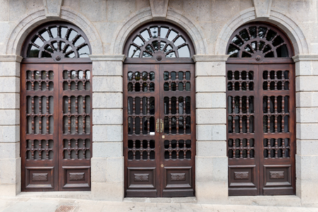 Three old wooden front doors with glass panes Stock Photo