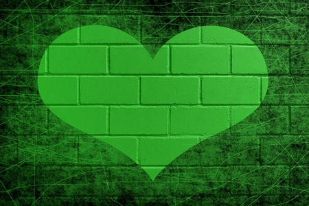 Green painted brick wall for background with heart Stock Photo