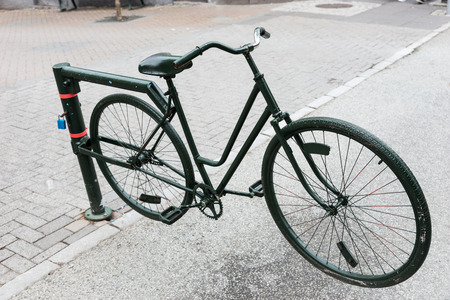 Old bicycle as a barrier on the boulevard