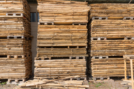 Wooden storage area of carpentry. Pile of wood for the construction industry