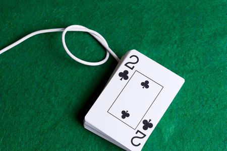 Poker cards as a laptop mouse. Cable with knots Reklamní fotografie