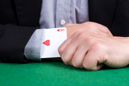 Card ace of hearts in the sleeve of the black suit Banco de Imagens