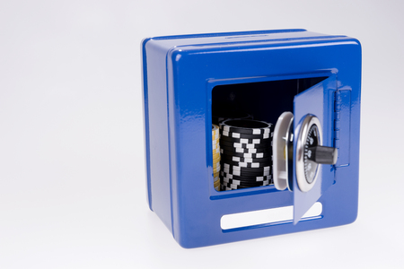 Blue steel safe with poker chips inside Stockfoto