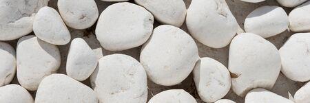 Panoramic background and texture of many white round stones Archivio Fotografico - 129479517