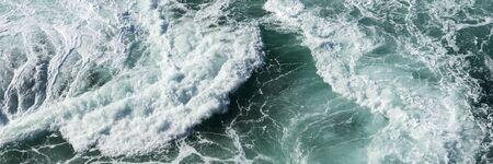 Panoramic water surface texture. Sea water splash with foamy wave Standard-Bild - 129479514