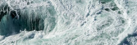 Panoramic water surface texture. Sea water splash with foamy wave