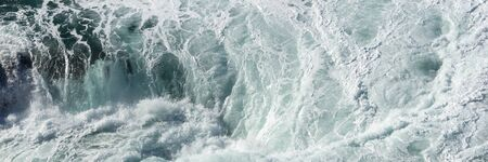 Panoramic water surface texture. Sea water splash with foamy wave Archivio Fotografico - 129479513