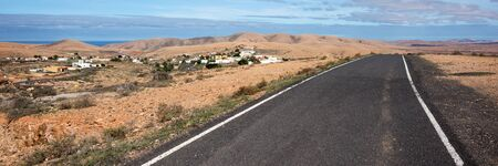 Panorama. Lonely Road in the mountains of Fuerteventura. Canary Islands. spain Archivio Fotografico - 129479516