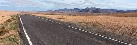 Panorama. Lonely Road in the mountains of Fuerteventura. Canary Islands. spain Archivio Fotografico - 129479520