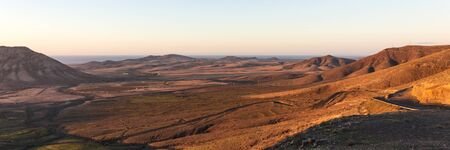 Panorama. Sunset in the mountains of Fuerteventura. Canary Islands. spain Archivio Fotografico - 129479503