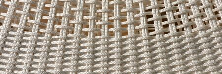 Woven panoramic light background. Simple abstract background of bright ropes Archivio Fotografico - 129479506