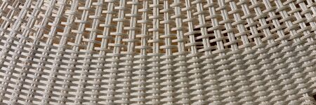 Woven panoramic light background. Simple abstract background of bright ropes Archivio Fotografico - 129479507