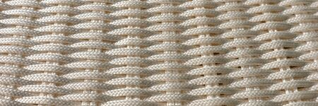 Woven panoramic light background. Simple abstract background of bright ropes Archivio Fotografico - 129479508