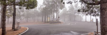 Smoke or fog in the mountains near the village Tejeda. Gran Canaria Archivio Fotografico - 129479511
