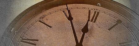 Panoramic image Retro clock with five minutes before twelve