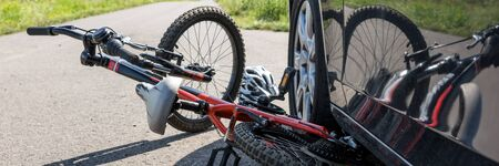 Children's bicycle accident on the street. Panoramic image
