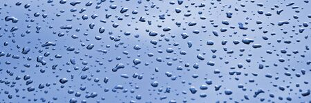 Panorama of many water drops on glass. Blue panoramic background Standard-Bild - 129479353