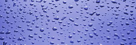 Panorama of many water drops on glass. Blue panoramic background Standard-Bild - 129479363