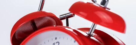 Panoramic image of a retro red alarm clock, time concept
