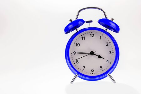 Blue retro alarm clock isolated on white, Time concept