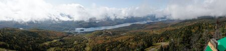 Panorama Lake Tremblant and Mont-Tremblant village from the top of Mont Tremblant. Quebec. canada Фото со стока