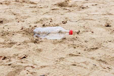 Discarded plastic water bottle in the sand on a beach Stok Fotoğraf