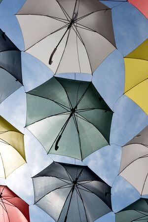 Colorful umbrellas in the sunshine. Rue du Cul-de-Sac, in the Quartier Petit Champlain, in Quebec City