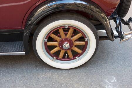 Wood spoke wheel on a classic american touring car
