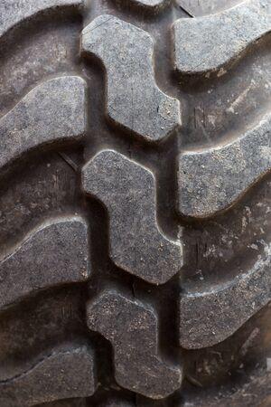 Closeup of a big tractor tire. Tire tread