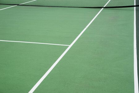View of a green tennis court. Side line of the tennis court