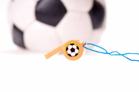 Plastic whistle with cord and soccer ball in the background Zdjęcie Seryjne