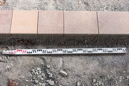 New colorful paving stones and meter measure. Start of construction work