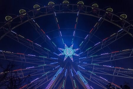 Detail of Ferris wheel at night with a blur and lens flares at the christmas market