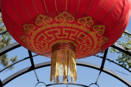 Beautiful round red lantern hanging in the garden. Concept of Chinese lunar new year festival 版權商用圖片