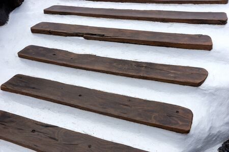 Dark brown wooden steps built in typical Canarian style. Lanzarote. Canary Islands. spain 版權商用圖片