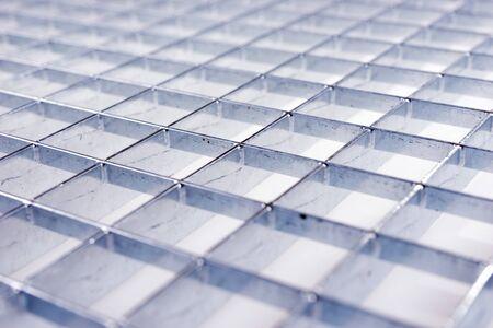 Industrial galvanized metal grid. Metal template background 版權商用圖片 - 138294245