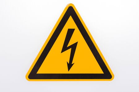 Warning sign High voltage yellow triangle isolated on white