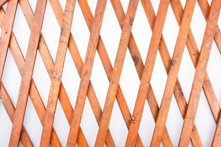 Texture of the wooden lattice isolated on white background. Natural wooden diagonal lattice. Top view 版權商用圖片