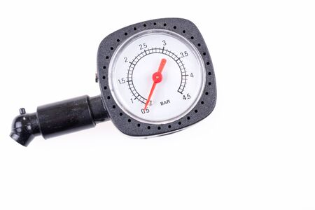 Pressure gauge for measuring air pressure in automobile tires isolated on white background