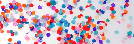 Panoramic image. Colorful confetti on white background. Happy celebration party