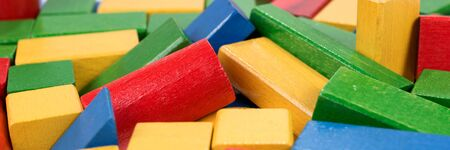 Panoramic image. Toys blocks, multicolor wooden building bricks