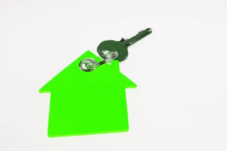 Key and green house with copy space for text. Symbol for environmentally conscious home ownership 版權商用圖片
