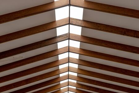 The inner roof consists of wooden beams and lets natural light through in the middle