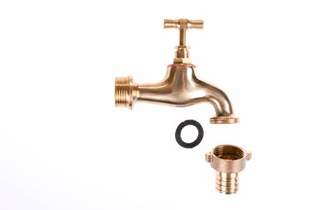 Classic brass faucet isolated on white background