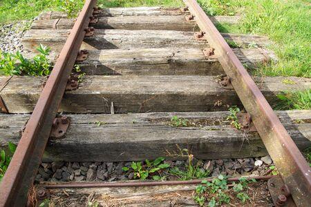 Closeup old railroad train rails and rail transport Banco de Imagens