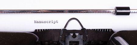 The word Manuscript typed on retro black typewriter